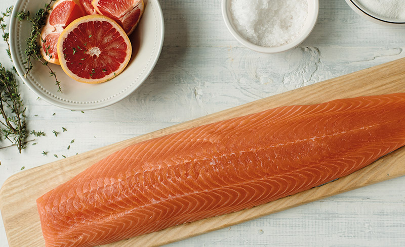 salmon being prepared on chopping board